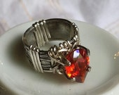 RESERVED  for Dalia.  Bright red 11 x 8mm faceted pear cut lab created CZ  on a wide floral patterned band.   Size 5