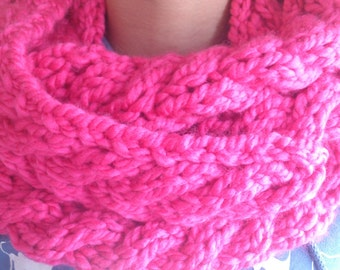 Warm home-knitted bright pink infinity scarf