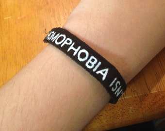 Homophobia Isn't Cute Leather Bracelet - Black