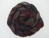 Wounded Ranger -- hand-dyed top in brown, grey, and black with splatters of bloody red. Custom blend of yak/mulberry silk. 4.35 oz