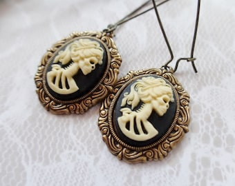 Earrings Matte Resin Ivory on Black She Skull And Brass Dangles