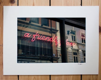 A4 mounted print of 'A friendly Place' neon sign