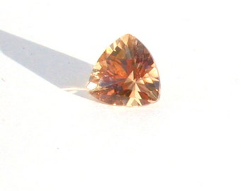 GOLDEN TOURMALINE TRILLIANT,custom cut for max brilliance,pink,peach and orange overtones, finest top quality 8.65mm 2.01ct magnificent gem.