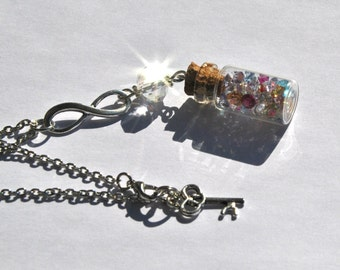 Necklace in a glass bottle, with colored rhinestones and infinite