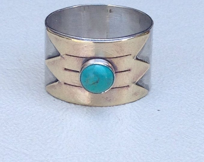 Sterling silver ring with brass design and turquoise stone