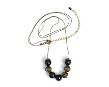 Popular items for long black necklace on etsy for Minimal art jewelry