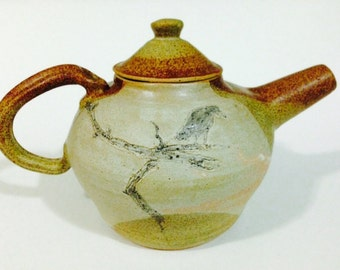 teapot with crow