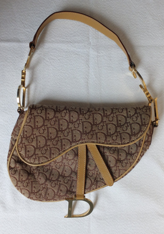 da0c76471 Dior Saddle Bag Vintage Vs New. Christian Dior Vintage Saddle Bag | eBay. Dior  Trotter Saddle Bag Trotter Canvas - LXRandCo - Pre-Owned Luxury Vintage