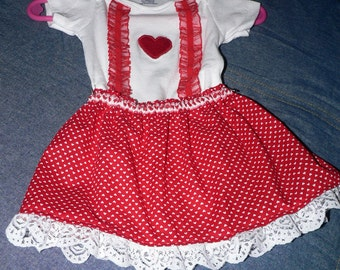 Decorated onesie with skirt, headband and little red shoes