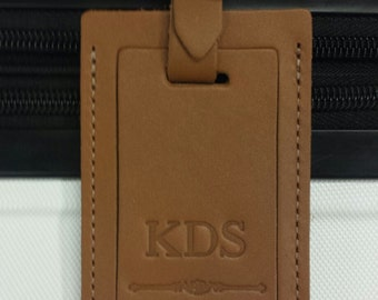 Our favorite personalized leather luggage tag. Boldly embossed and personalized with FREE initials. Simply stunning.
