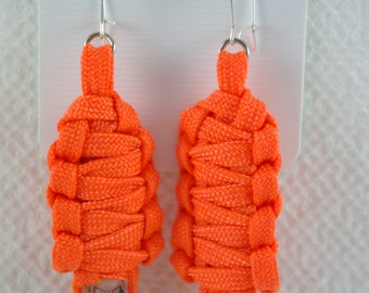 Paracord Mummy Earrings Neon people can see you for miles Orange color the skulls glow in the dark