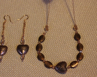 Exquisite copper fish, swarovski crystals and swirls, make this set of earrings and necklace a beautiful combination.