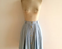 Light blue skirt with printing small white flowers / Size S
