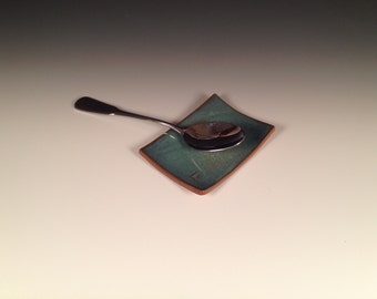 Turquoise spoon rest; hand-textured and stamped; dark tan clay