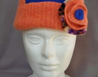 Handmade women's lavender and peach felted Merino wool beanie hat with cuff and flower pin. Reversible.