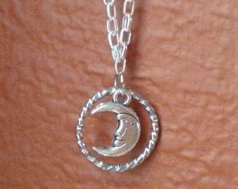 Silver necklace with floating moon and leather pad