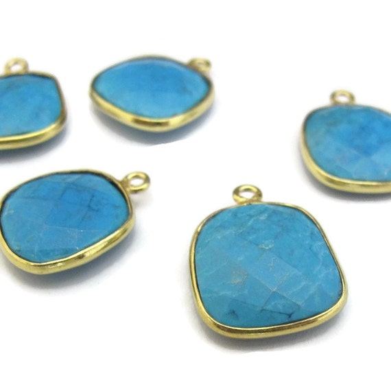 one turquoise charm with gold plated bezel square shaped