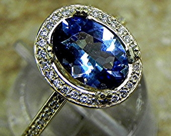 AAA Tanzanite 1.75 Carats 10 X 7mm. in a 14k Yellow gold ring with diamonds (.32ct) Ring 1807