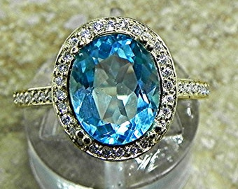 AAA Swiss Blue Topaz 3.26 Carats 10 X 8mm. in a 14k Yellow gold ring with diamonds (.32ct) Ring 1816