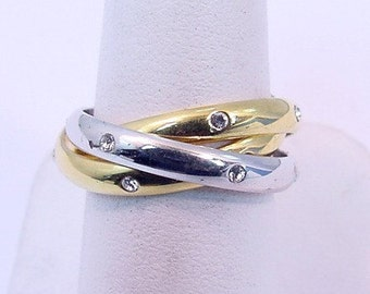 14K Tri color gold rolling Diamond wedding rings.  Set with .24 carats of diamonds