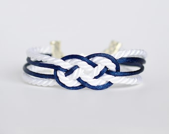 Navy blue and white double infinity knot nautical rope bracelet with silver anchor charm