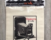 Organizational camera and phone cord bags,