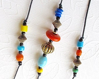 Beaded Wind Chime: Garden Chime with Multicolor Opaque Glass Beads. Fiesta Colors. Orange. Turquoise. Jadite Green. Yellow. Blue. Brass Bell