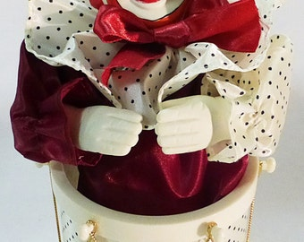 Music box clown moving head sitting on a drum 1989