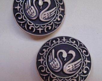1950s Napier SWAN earrings. Clip on.1 1/2 inches. Plastic.