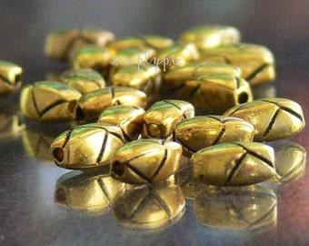 Carved Oval Antiqued Gold Metal Beads 7x4mm 20
