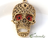 SALE: Antique gold skull pendant with rhinestone eyes - one pendant