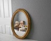 large victorian ornate oval wall mirror / decorative gold wall hanging / lightweight