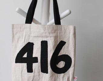 416 toronto area code tote bag