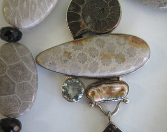 Ammonite, fossil coral, and smokey quartz statement necklace