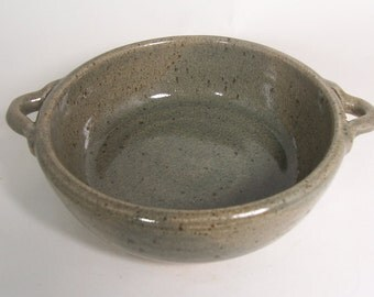 Rustic stoneware baking dish. With loop handles, celadon glaze.