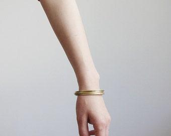 Brass bangle bracelet set. Gold tone brass bangles. Skinny stacking bracelets.