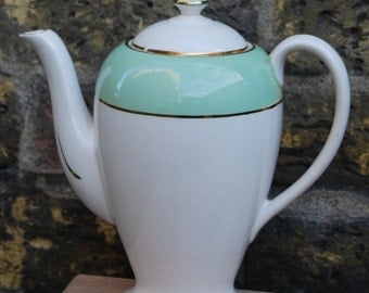 Vintage coffee pot with pastel green, white and gold design