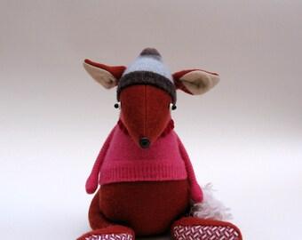 Orange Woollen Fox - Handmade plush fox wearing pink cashmere pullover and stripey woolly hat.