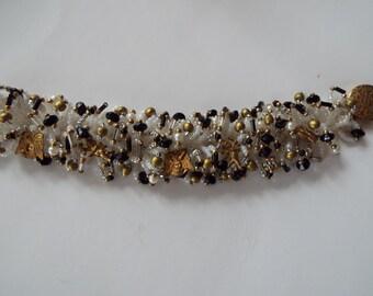 hand crocheted  fringe bracelet woven crystal beads  brass charms