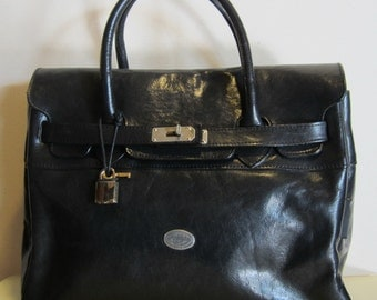 Vintage leather handbag.  Kelly bag model, black, with lock and key, vg condition, France.