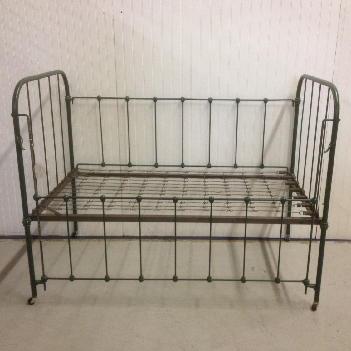 vintage iron baby crib with springs photo by
