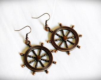 Red copper helm earrings. Big ship wheel earrings.