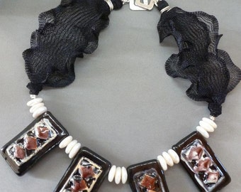 Dominos Choker stacks four chunky handmade Kenyan ceramic rectangles with coin pearls on ruffled black Artistic Wire and a silver clasp