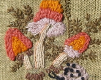 Vintage Seventies Embroidery: Mushroms and a Snail in Round Gold Plastic Frame circa 1970s
