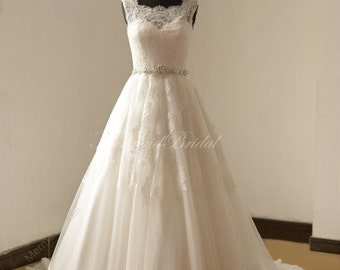 Open back Ivory a line lace wedding dress with illusion neckline and beads sash