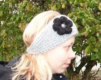 Chunky handknitted grey headband/earwarmer with black crocheted flower