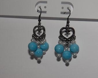 Dangling heart earrings with light blue beads