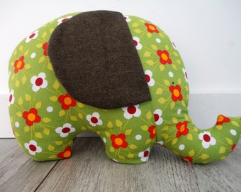 Stuffed toy elephant with rattle