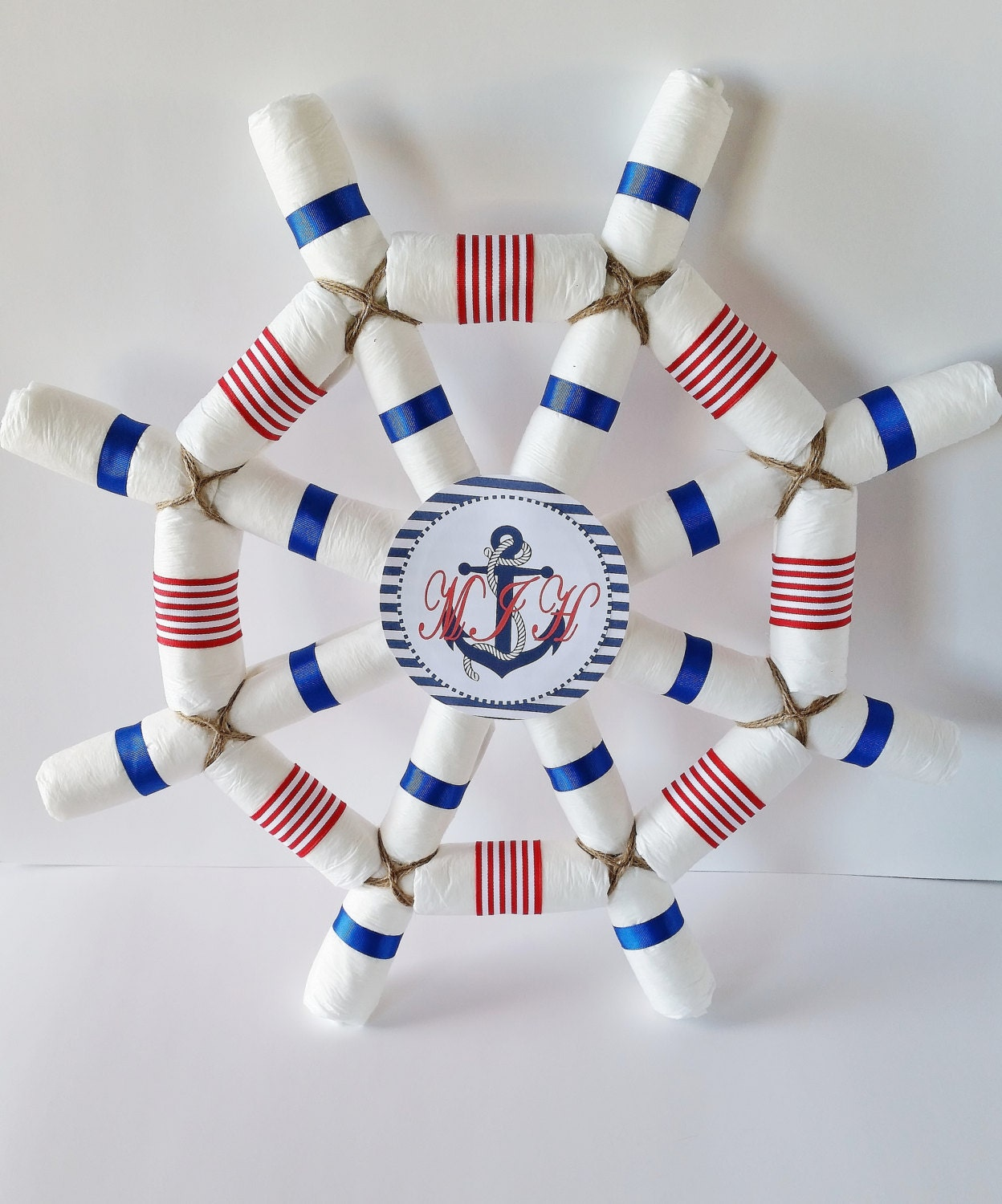 Nautical baby shower centerpiece captains wheel diaper cake for Baby shower nautical decoration