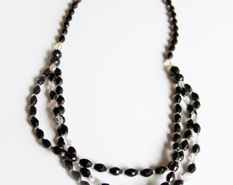 Vintage triple strand glass bead necklace, Black and AB faceted glass beads, unsigned